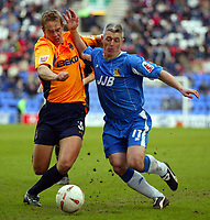 Photo: Chris Brunskill. Wigan Athletic v Milwall. Coca-Cola Championship. 12/03/2005. Graham Kavanagh of Wigan and Paul Robinson of Milwall battle for the ball.