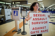 24 NOVEMBER 2010 - PHOENIX, AZ:  HALINA REED, who said she is a survivor of sexual assault, pickets a concourse to protest intrusive Transportation Security Administration (TSA) pat downs and body scans at Sky Harbor International Airport in Phoenix Wednesday, Nov. 24. About 30 people protested TSA searches at the Phoenix airport. The Wednesday before Thanksgiving is traditionally one of the busiest travel days of the year. The protest against the TSA pat downs and body scans did not disrupt holiday travel in Phoenix.  Photo by Jack Kurtz