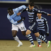 Kwadwo Poku, (left), NYCFC, wins a battle for the ball with Servando Carrasco, Sporting KC, during the New York City FC Vs Sporting Kansas City, MSL regular season football match at Yankee Stadium, The Bronx, New York,  USA. 27th March 2015. Photo Tim Clayton