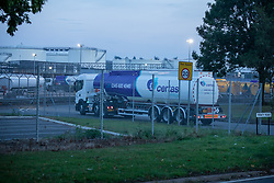© Licensed to London News Pictures. 26/09/2021. Kingsbury, Warwickshire, UK. The scene as dawn breaks on a Sunday morning outside Kingsbury fuel depot, the main fuel distribution site in the Midlands. Pictured a fuel tanker arrives back at the Kingsbury site after an overnight delivery. Photo credit: Dave Warren / LNP