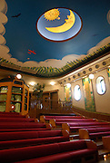 A cinema in the museum. The seats are child-sized. The Ghibli Museum in Mitaka, western Tokyo opened in 2001. It was designed by animator Miyazaki Hayao and receives around 650,500 visitors each year.