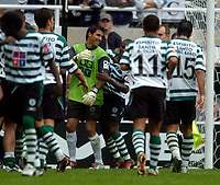 Photo. Jed Wee, Digitalsport<br /> Feyenoord Rotterdam v Sporting Lisbon, Newcastle Gateshead Cup, 31/07/2004.<br /> Sporting substitute goalkeeper Ricardo Pereira is the toast of his team after the penalty shootout.. Ricardo also scored the winning penalty for Portugal against England at Euro 2004,