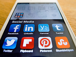 Detail of iPhone 5 smartphone screen showing Social Media apps icons