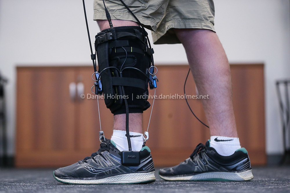 (7/18/19, MARLBOROUGH, MA) Chris Jasinski, an engineer at ReWalk Robotics, demonstrates the ReStore Soft Exo-Suit in Marlborough on Thursday. The ReWalk was developed to help assist individuals who have suffered from a stroke. [Daily News and Wicked Local Photo/Dan Holmes]