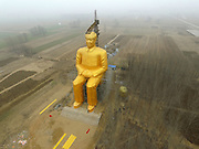 TONGXU, CHINA - JANUARY 04: (CHINA OUT) <br /> <br /> A huge statue of Chairman Mao Zedong, 36.6 meters in height, is under construction at Zhushigang village on January 4, 2015 in Tongxu County, Henan Province of China. The statue costs nearly 3 million yuan (459,300 USD) donated by several entrepreneurs and some villagers in Zhushigang village.<br /> ©Exclusivepix Media