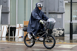 © Licensed to London News Pictures. 14/09/2021. London, UK. A cyclist wearing a raincoat during rainfall in north London. A yellow weather warning for heavy rain is in place in London and parts of South East England. Photo credit: Dinendra Haria/LNP