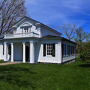 """""""Robert Frost House""""<br /> <br /> Robert Frost had a home in Ann Arbor Michigan during his time at The University of Michigan. This house is now located in Greenfield Village  in Dearborn Michigan. This photograph was made in early spring on a wonderful warm day filled with blue skies and green grass!"""