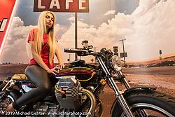 A model adorns a custom Moto-Guzzi at Motor Bike Expo. Verona, Italy. Thursday January 18, 2018. Photography ©2018 Michael Lichter.