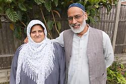 Older couple smiling,