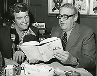 1978 Radio commentator and interviewer, Gregg Hunter, seen interviewing author, Hilliard Marks, during his KIEV radio show at the Brown Derby Restaurant on Vine St. in Hollywood