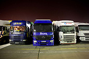 HGV Lorries parked overnight at The Orwell Crossing, a 24hour traditional transport cafe and lorry park serving nearby Felixstowe Docks along the A14 on the 10th December 2009 in Ipswich in the United Kingdom.