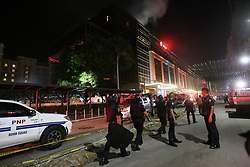 June 2, 2017  - Pasay City, Philippines - Police officers secure the surroundings of Resorts World Manila after an attack. A gunman with an assault rifle burst into the casino, fired shots and set gaming tables on fire on Friday. There is no indication the attack was an act of terrorism, the country's police chief said. (Credit Image: © Xinhua via ZUMA Wire)