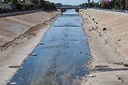 Large amounts of trash and plastic refuse collect in Ballona Creek after first major rain storm of the season. Ballona Creek. Once a meandering creek, is now a concreted nine-mile flood channel that drains the Los Angeles Basin and watershed down into the Pacific Ocean, Culver City, California, USA