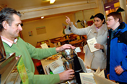 Man with learning disabilities in cafe with carer; Bradford; Yorkshire UK