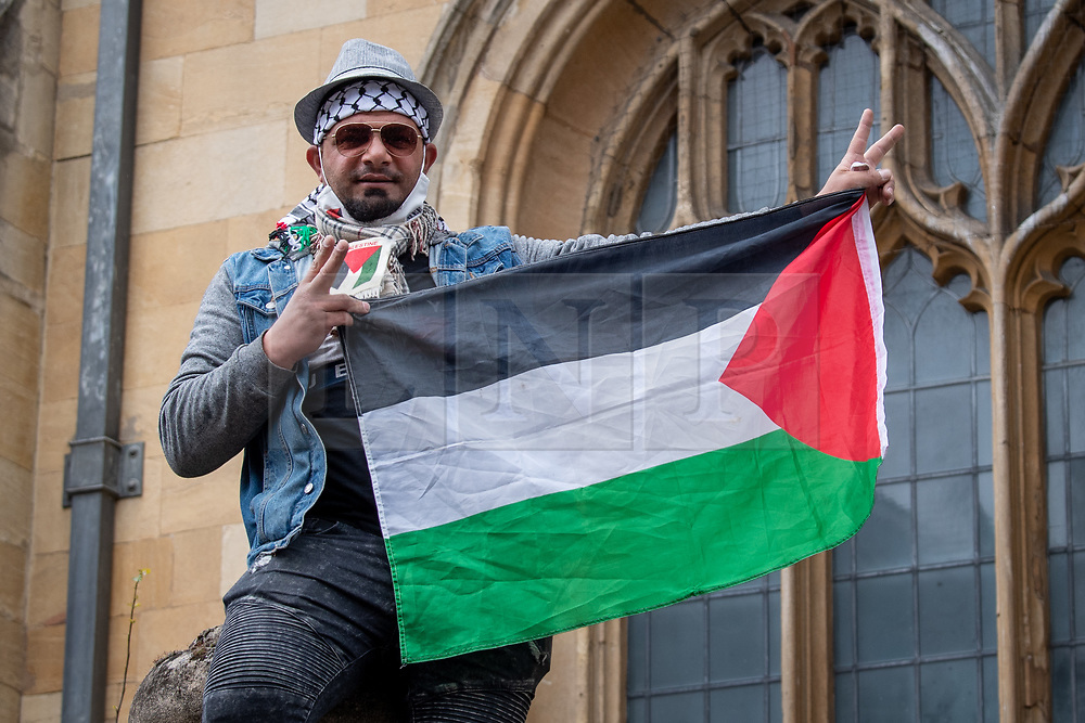 © Licensed to London News Pictures. 16/05/2021. Oxford, UK. A man holds a Palestinian flag at the 'Speak up for Palestine' demonstration held in Oxford, the crowd marched on the planned route from Manzil Way to Bonn Square in central Oxford. Photo credit: Peter Manning/LNP