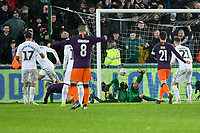 Football - 2018 / 2019 Emirates FA Cup - Quarter-Final: Swansea City vs. Manchester City<br /> <br /> Substitute Aguero beats Swansea keeper Kristoffer Nordfeldt with a diving header off Bernardo Silva's low cross at the end of a superb move in the 88th minute., at The Liberty Stadium.<br /> <br /> COLORSPORT/WINSTON BYNORTH