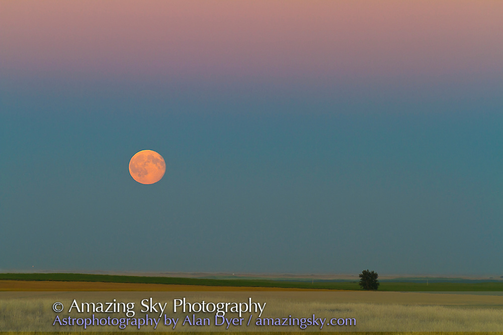 Moonrise the day after Full Moon, over the prairies, southern Alberta on August 25, 2010. Taken with a Canon 7D and 200mm lens
