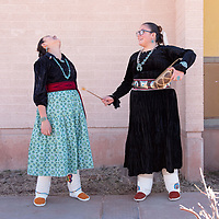 Landing Middle School students Meike Sampson, 12, left, and Meilin Dyer, 11, right, spend time practicing their Navajo love song duet, outside of the auditorium before their performance for the 46th Annual Diné Song & Dance Festival at Rock Point Community School. In Rock Point on Wednesday.