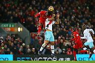 Divock Origi of Liverpool gets above Winston Reid of West Ham United to head the ball. Premier League match, Liverpool v West Ham Utd at the Anfield stadium in Liverpool, Merseyside on Sunday 11th December 2016.<br /> pic by Chris Stading, Andrew Orchard sports photography.
