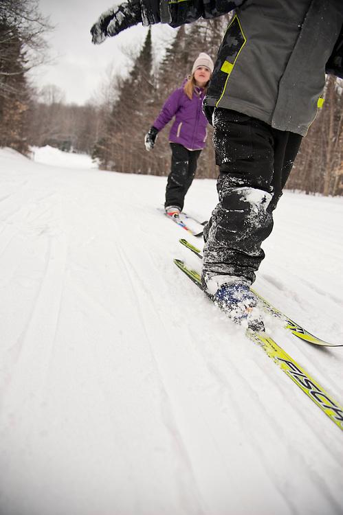 Nordic skier Cross Country skier kids children at Valley Spur ski area of Hiawatha National Forest in Michigan's Upper Peninsula near Munising Michigan.