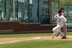 17 April 2016:  John Bosco turns teh corner at 3rd base during an NCAA division 3 College Conference of Illinois and Wisconsin (CCIW) Pay in Baseball game during the Conference Championship series between the North Central Cardinals and the Illinois Wesleyan Titans at Jack Horenberger Stadium, Bloomington IL