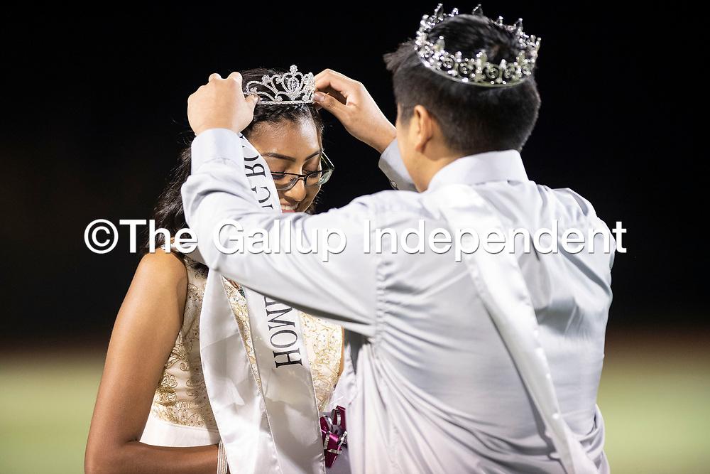 Homecoming King Javon Chavez puts a tirara on Kaylee Kallestewa who was named Homecoming  Queen during halftime at the Ramah Mustangs and Navajo Pine Warriors football game, Thursday, Oct. 11, 2018.