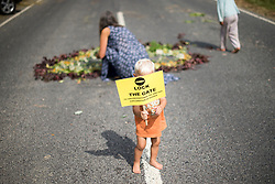 *permission given by parents to photograph child* © London News Pictures.  27/07/2013. Balcombe, UK. Anti Fracking demonstrators and local villagers attempt to blockade a drilling site in Balcombe, West Sussex which has been earmarked for fracking. Photo credit: Ben Cawthra/LNP