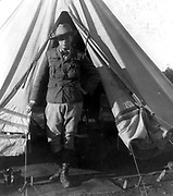 Winston Spencer Churchill (1874-1965) British statesman, as a war correspondent during the Second Boer War, Bloemfontein, South Africa, 1900. Churchill standing at the opening of his tent.