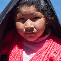A girl posing near her house on Taquile Island.