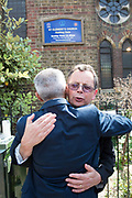 London Mayor, Sadiq Khan hugs Vicar Alan Everett outside St Clement's Church on 18th June 2017 in North Kensington, London, United Kingdom. The Grenfell Tower fire occurred on 14th June 2017 at the 24-storey block of public housing flats in North Kensington, West London. It caused at least 80 deaths and over 70 injuries, yet the actual numbers have yet to be confirmed