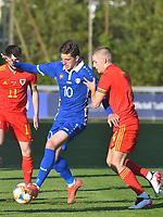Football - 2023 UEFA U21 Championship - Qualifying - Group E - Wales vs Moldova - Steboneath Park, Llanelli<br /> <br /> Iosipoi Moldova on the attack Ryan Stirk Wales defends <br /> <br /> COLORSPORT/WINSTON BYNORTH