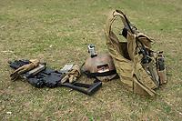 """03 APR 2012, LEHNIN/GERMANY:<br /> Gewehr G36, Helm und Schutzweste mit Funkgeraet nach einer Uebung, Kampfschwimmer der Bundeswehr trainieren """"an Land"""" infanteristische Kampf, hier Haeuserkampf- und Geiselbefreiungsszenarien auf einem Truppenuebungsplatz<br /> IMAGE: 20120403-01<br /> KEYWORDS: Marine, Bundesmarine, Soldat, Soldaten, Armee, Streitkraefte, Spezialkraefte, Spezialkräfte, Kommandoeinsatz, Übung, Uebung, Training, Spezialisierten Einsatzkraeften Marine, Waffentaucher"""