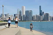 Walkers and bikers along the Chicago lakefront in Chicago, Illinois.<br /> Photo by Mark Black