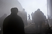 Moscow, Russia, 23/01/2006..Muscovites on their way to work exit through steam rising from a metro entrance as a Siberian weather front brings temperatures down to minus 36C in the Russian capital and leads to power cuts in the city.