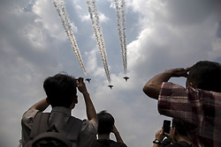 August 17, 2017 - Jakarta, Indonesia - Jets fly in formation above the Indonesian Palace at Merdeka Street as Indonesia celebrates its 72nd Independence day. (Credit Image: © Donal Husni via ZUMA Wire)