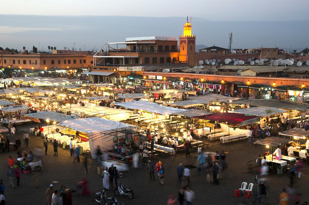 Bustling Jemaa El Fna square at dusk in Marrakech Morocco