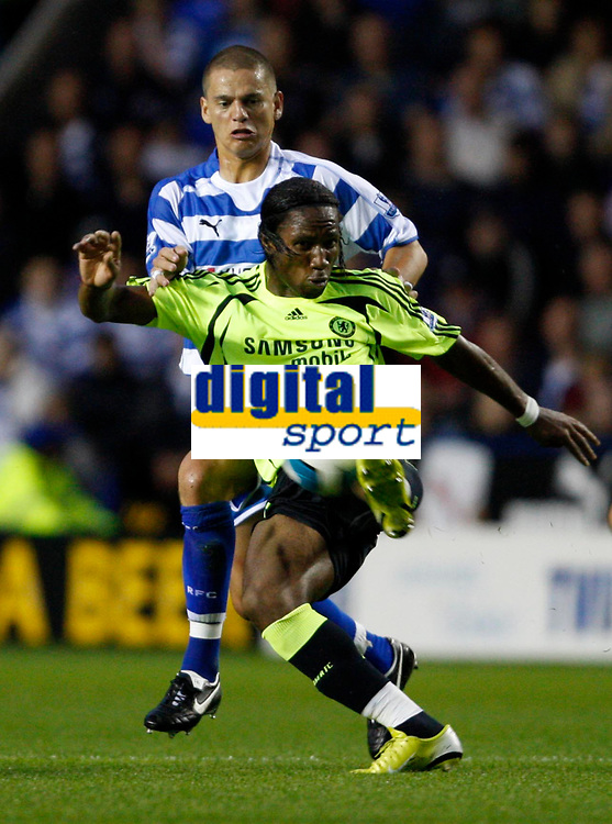Photo: Richard Lane/Sportsbeat Images.<br />Reading v Chelsea. The FA Barclays Premiership. 15/08/2007. <br />Chelsea's Didier Drogba is challenged by Reading's Ivar Ingimarsson.