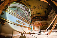 Superintendant Bob Ferguson from Bonnette, Page and Stone shines his flashlight to show the intricate paintings in the upper balcony ceiling of the Colonial Theater in downtown Laconia.  (Karen Bobotas/for the Laconia Daily Sun)