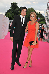 VERNON KAY and TESS DALY at the F1 Party in aid of Great Ormond Street Hospital Children's Charity held at Battersea Evolution, Battersea Park, London on 4th July 2012.