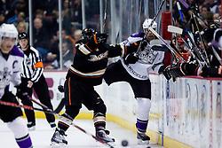 Brandon McMillan (Anaheim Ducks, #64) vs Willie Mitchell (Los Angeles Kings, #33) during ice-hockey match between Anaheim Ducks and Los Angeles Kings in NHL league, Februar 23, 2011 at Honda Center, Anaheim, USA. (Photo By Matic Klansek Velej / Sportida.com)