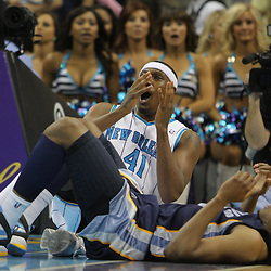 Jan 20, 2010; New Orleans, LA, USA; New Orleans Hornets forward James Posey (41) reacts after being called for a foul against Memphis Grizzlies forward Rudy Gay (bottom) during the second half at the New Orleans Arena. The Hornets defeated the Grizzlies 113-111. Mandatory Credit: Derick E. Hingle-US PRESSWIRE