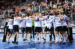 Team of Germany celebrates during 21st Men's World Handball Championship preliminary Group C match between National teams of Germany and Poland, on January 22, 2009, in Arena Varazdin, Varazdin, Croatia.  (Photo by Vid Ponikvar / Sportida)