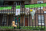 Childrens' bears and cuddly toys and some of the victims' names on railings near where the Grenfell fire occured, on the first anniversary of the tower block disaster, on 14th June 2018, in London, England. 72 people died when the tower block in the borough of Kensington & Chelsea were killed in what has been called the largest fire since WW2. The 24-storey Grenfell Tower block of public housing flats in North Kensington, West London, United Kingdom. It caused 72 deaths, out of the 293 people in the building, including 2 who escaped and died in hospital. Over 70 were injured and left traumatised. A 72-second national silence was held at midday, also observed across the country, including at government buildings, Parliament.