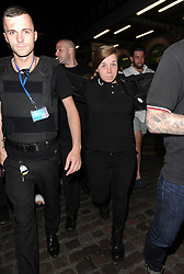 Katie Price and husband Kieran Hayler are seen being escorted to safety by a security team, following the cancellation of her gig at G.A.Y, due to the terrorist attacks in London. Katie was wearing a black t-shirt, Adidas tracksuit bottoms and white fluffy flip flops, as she walked with Kieran, flanked by a group of 8 private  security.<br /><br />4 June 2017.<br /><br />Please byline: Will/Craig/Vantagenews.com