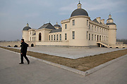 A man walks through the grounds of the Chateau Changyu Moser XV, which will be open to the public next May, in Yinchuan, Ningxia Hui Autonomous Region, China on 21 December  2012.  With its dry climates and ample sunshine, and encouraged by the huge boom in Chinese consumer's demand for wine, Ningxia is quickly becoming one of the biggest wine producing regions in China.