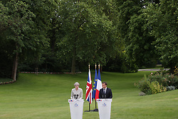 French President Emmanuel Macron and Prime Minister Theresa May speak at a joint press conference at the Elysee Palace during her visit to Paris, France.