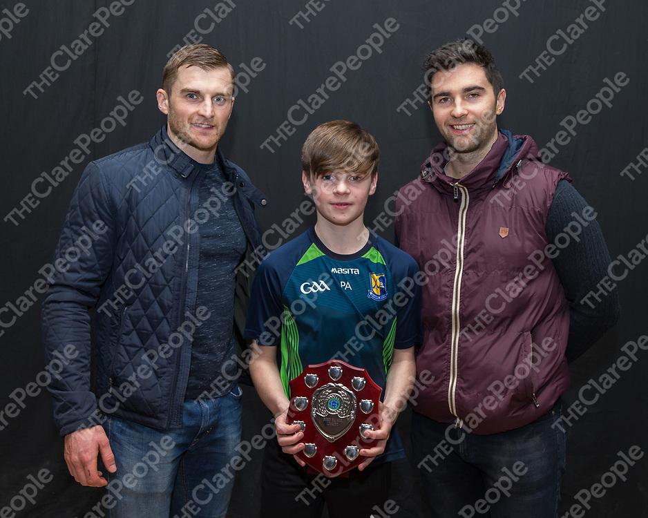 Patrick Ahearne with Sixmilebridge hurlers Seadna and Alex Morey