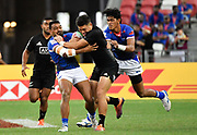 New Zealand's Tone Ng Shiu is held by Samoa's David Afamasaga during the HSBC Singapore Rugby Sevens 5th Place Play-off - Samoa v New Zealand won by Samoa 19-17 at The National Stadium, Singapore, Sunday, April 14th, 2019. (Steve Flynn/Image of Sport)