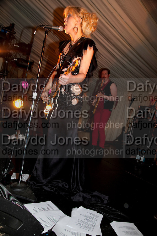 COURTNEY LOVE PERFORMING WITH LYRICS ON THE FLOOR, The Goodwood Ball. In aid of Gt. Ormond St. hospital. Goodwood House. 27 July 2011. <br /> <br />  , -DO NOT ARCHIVE-© Copyright Photograph by Dafydd Jones. 248 Clapham Rd. London SW9 0PZ. Tel 0207 820 0771. www.dafjones.com.
