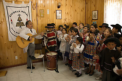 Chile, Lake Country: Children at one room rural schoolhouse in Peulla..Photo #: ch668-33923.Photo copyright Lee Foster www.fostertravel.com, lee@fostertravel.com, 510-549-2202.